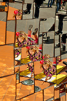 A young artist is reflected in the mirrors of the Firebird statue outside the Bechtler Museum. The girl was among the thousands of people who came downtown during the Wells Fargo Community Celebration, held October 29, 2011 in downtown Charlotte NC. The daylong festival took place in the streets, in public atriums and in downtown museums, which offered free admission all day long. Wells Fargo, which this month completed its conversion from Wachovia, picked up the bill.