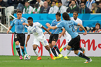 Raheem Sterling of England takes on Nicolas Lodeiro and Cristian Rodriguez of Uruguay