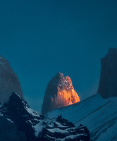 Paine Mastiff horns  and one of the Towers light up at sunrise . Torres del Paine National Park, Chile, Patagonia