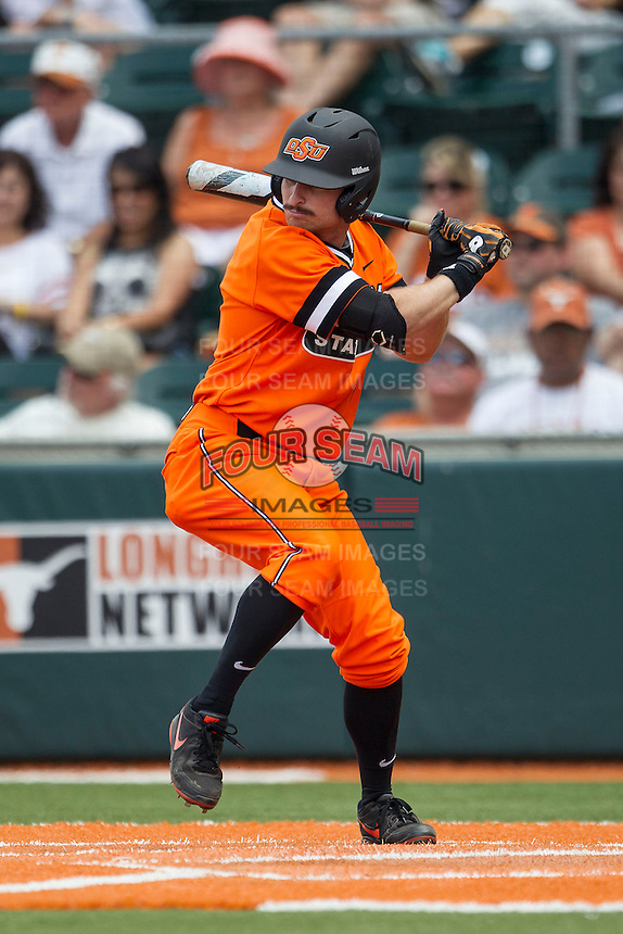 Oklahoma State Cowboys outfielder Saulyer Saxon #3 at bat during the NCAA baseball game against the Texas Longhorns on April 26, 2014 at UFCU Disch–Falk Field in Austin, Texas. The Cowboys defeated the Longhorns 2-1. (Andrew Woolley/Four Seam Images)