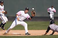 August 30, 2009: Everett AquaSox second baseman Ben Billingsley covers second base on a stolen base attempt during a Northwest League game against Salem-Keizer Volcanoes at Everett Memorial Stadium in Everett, Washington.  The AquaSox wore pink jerseys for breast cancer awareness.