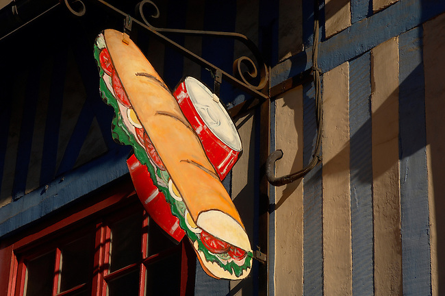 Harbour side restauarants signs - Fast food baguette & can of drink. Honfleur, Normandy, France.
