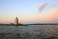 Sunset at Dutch Island Lighthouse prior to restoration.