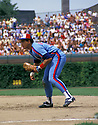 Montreal Expos Andres Galarraga (14) in action during a game from the 1990 season against the Chicago Cubs at Wrigley Field in Chicago, Illinois. Andres Galarraga played for 19 years with 7 different teams.