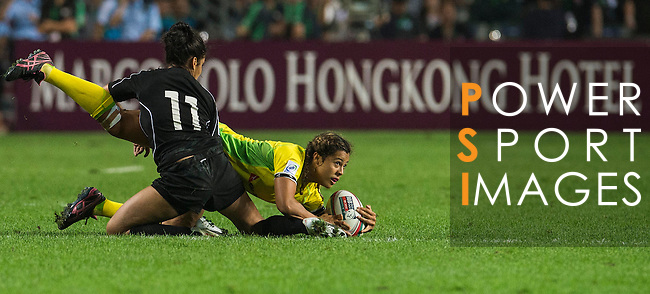 Australia play Canada in the Women's Rugby Sevens Cup Final on Day 1 of the Cathay Pacific / HSBC Hong Kong Sevens 2013 at Hong Kong Stadium, Hong Kong. Photo by Aitor Alcalde / The Power of Sport Images