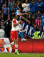 BOGOTA - COLOMBIA - 16 – 07 - 2017: Andres Cadavid (Der.) jugador de Millonarios salta a cabecear el balón con con Denis Stracqualursi (Izq.) jugador de Independiente Santa Fe, durante partido de la fecha 2 entre Millonarios y el Independiente Santa Fe, por la Liga Aguila II-2017, jugado en el estadio Nemesio Camacho El Campin de la ciudad de Bogota. / Andres Cadavid (R) player of Millonarios jump to the head of the ball the ball with con Denis Stracqualursi (L) player of Independiente Santa Fe, during a match of the date 2nd between Millonarios and Independiente Santa Fe, for the Liga Aguila II-2017 played at the Nemesio Camacho El Campin Stadium in Bogota city, Photo: VizzorImage / Luis Ramirez / Staff.