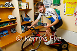 Tom Moriarty at home in Castlegregory, and is doing his cycling training indoors with the aid of an app on his phone.