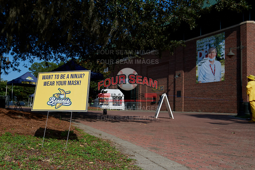 A sign reminding fans to wear a mask outside the gates before a Collegiate Summer League game  between the Macon Bacon and Savannah Bananas on July 15, 2020 at Grayson Stadium in Savannah, Georgia.  (Mike Janes/Four Seam Images)