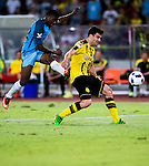 Manchester City striker Kelechi Iheanacho (l) attempts a kick while being defended by Borussia Dortmund defender Sokratis Papastathopoulos (r) during the 2016 International Champions Cup China match at the Shenzhen Stadium on 28 July 2016 in Shenzhen, China. Photo by Marcio Machado / Power Sport Images
