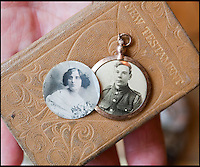 BNPS.co.uk (01202 558833)<br /> Pic: PhilYeomans/BNPS<br /> <br /> Pte Ambrose bible and locket pictures of him and his sweetheart Gladys.<br /> <br /> Discovered in a loft - Poingnant reminder of families tragic loss during the Great War.<br /> <br /> A moving time capsule containing the last belongings of a dead soldier his family couldn't bring themselves to look at has been found in an attic after 98 years.<br /> <br /> The possessions of Private Edward Ambrose were sent home from the Western Front to his devastated parents after he was killed at the Somme.<br /> <br /> Too painful to look at, the poignant items were shut into a leather case and put into storage where they remained for almost a century.<br /> <br /> The case has now been opened by Pvt Ambrose's 82-year-old nephew who recovered it after reading about an appeal for untold stories for a local First World War exhibition.<br /> <br /> The effects include black and white photos of his loved ones, letters from his parents, his half-smoked pipe and a cigarette case with 10 roll-ups.