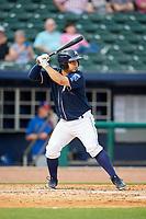 Northwest Arkansas Naturals catcher Luis Villegas (19) at bat during a game against the Midland RockHounds on May 27, 2017 at Arvest Ballpark in Springdale, Arkansas.  NW Arkansas defeated Midland 3-2.  (Mike Janes/Four Seam Images)
