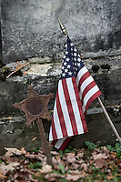 American flag next to vetran grave stone, Vermont, USA