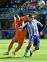 DUNDEE UTD'S DAVID GOODWILLIE AND KILMARNOCK'S RORY MCKEOWN CHALLENGE FOR THE BALL