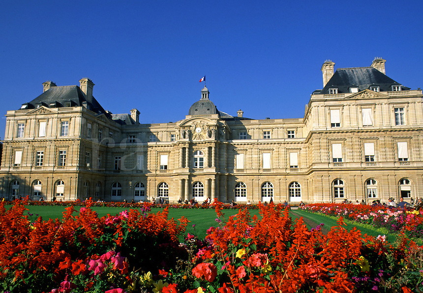 The exterior of the Luxembourg Palace and landscaped grounds with border flower gardens. Paris, France.