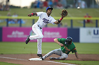 Kannapolis Cannon Ballers third baseman DJ Gladney (8) reaches for a throw as Evan Carter (11) of the Down East Wood Ducks steals third base at Atrium Health Ballpark in May 5, 2021 in Kannapolis, North Carolina. (Brian Westerholt/Four Seam Images)