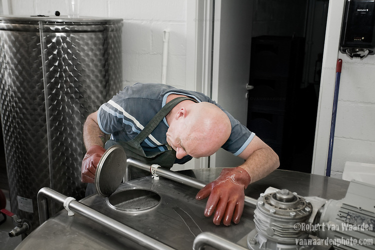 Brewmaster Tommy inspects the beer. This small brewery in Raervig, Denmark is a new brewery on the competitive scene of micro brewers in Europe.