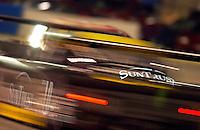 Rolex 24 at Daytona, Daytona International Speedway 5/6 Feb, 2005.The #10 SunTrust Pontiac/Riley races into the International Horseshoe in pursuit of another competitor..Copyright©F.Peirce Williams 2005