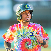29 July 2016: Vermont Lake Monsters outfielder Luis Barrera sports a colorful uniform celebrating Ben & Jerry's Summer of Love Day as he returns to the dugout during a game against the Brooklyn Cyclones at Centennial Field in Burlington, Vermont. The Lake Monsters fell to the Cyclones 8-5 in NY Penn League action. Mandatory Credit: Ed Wolfstein Photo *** RAW (NEF) Image File Available ***