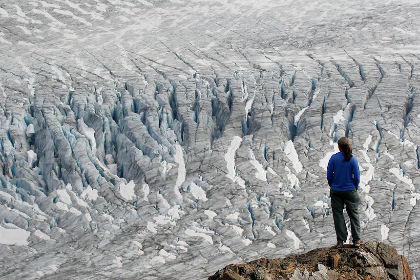 A hiker views Exit Glacier and the Harding Icefield from the Harding Icefield trail, Kenai Fjords National Park, Alaska.  (MR