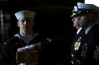 130513-N-DR144-089 PACIFIC OCEAN (May 13, 2013)- Electrician's Mate 2nd Class Chris Pike carries the ashes of a former service member to be committed to the sea during a burial at sea aboard San Antonio-class amphibious transport dock ship USS Anchorage (LPD 23).  Anchorage is underway after being commissioned in its namesake city of Anchorage, Alaska. (U.S. Navy photo by Mass Communication Specialist 1st Class James R. Evans / RELEASED)