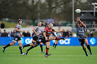 Charlie Hodgson of Saracens kicks over the head of Bismarck du Plessis of Sharks during the Sanlam Private Investments Shield match between Saracens and the Cell C Sharks at Allianz Park on Saturday 25th January 2014 (Photo by Rob Munro)