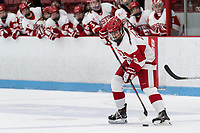 BOSTON, MA - FEBRUARY 16: Courtney Correia #5 of Boston University controls the puck during a game between University of New Hampshire and Boston University at Walter Brown Arena on February 16, 2020 in Boston, Massachusetts.