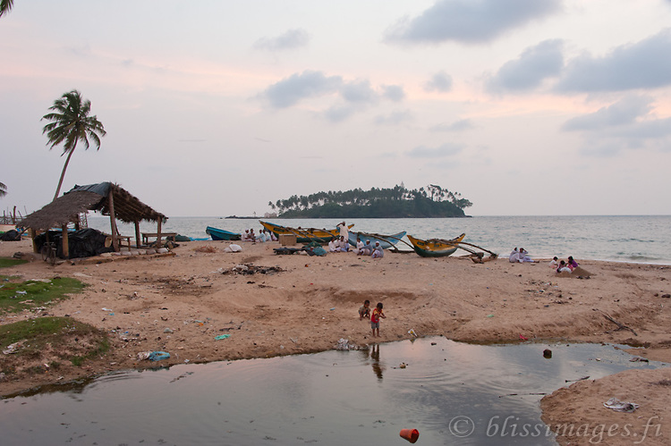Tamil fishermen congregate to chat and kids play at day's end -Beruwala village, Sri Lanka