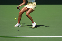A woman plays tennis on a court.