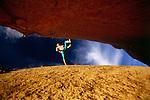 Rock climber jumping across rock formation, low angle view, Baja, Catavina Desert Region, Mexico