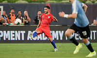 St. Louis, MO - SEPTEMBER 10: Cristian Roldan #7 of the United States passes off a ball during their game versus Uruguay at Busch Stadium, on September 10, 2019 in St. Louis, MO.