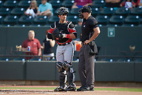 Carolina Mudcats catcher Payton Henry (15) and home plate umpire Dane Poncsak during the game against the Winston-Salem Dash at BB&T Ballpark on June 1, 2019 in Winston-Salem, North Carolina. The Mudcats defeated the Dash 6-3 in game one of a double header. (Brian Westerholt/Four Seam Images)