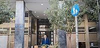 Pictured: A man in sunglasses exits a building.<br /> Re: Street photography, Athens, Greece. Thursday 27 February 2020
