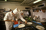 Chefs at work in a commercial kitchen <br /> at Fishmongers Hall, the City of London.   The Worshipful Company of Fishmongers hold a  banquet for the fish trade  1992 1990s.