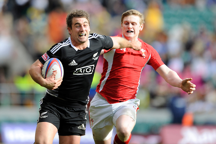 Kurt Baker of New Zealand hands off Dafydd Howells of Wales during the iRB Marriott London Sevens at Twickenham on Saturday 11th May 2013 (Photo by Rob Munro)