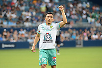 KANSAS CITY, KS - AUGUST 10: Angel Mena #13 Club Leon celebrates a goal during a game between Club Leon and Sporting Kansas City at Children's Mercy Park on August 10, 2021 in Kansas City, Kansas.