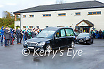 Killarney Legion players and supporters give a guard of honour for former player Derek Twomey as his coffin leaves Dirren  on Monday