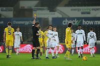 Yan Dhanda of Swansea City U21 is shown a yellow card during the Checkatrade Trophy match between Swansea City U21 and Bristol Rovers at the Liberty Stadium in Swansea, Wales, UK. Wednesday 05 December 2018