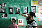Tran Thi Hoa, 47, points to a baby photograph of her 21-year-old son La Thanh Toan, who sits below it, at their home near Da Nang, Vietnam. The photograph was taken when Toan was 4-years old, and shows him as a normal child. But he and his brother Nghia, now 18, are third generation victims of dioxin exposure, the result of the U.S. military's use of Agent Orange and other herbicides during the Vietnam War more than 40 years ago. The brothers were born healthy, but began to suffer from muscular dystrophy and other problems as they grew older. They are now confined at home as their bodies and lives  waste away. The Vietnam Red Cross estimates that 3 million Vietnamese suffer from illnesses related to dioxin exposure, including at least 150,000 people born with severe birth defects since the end of the war. The U.S. government is paying to clean up dioxin-contaminated soil at the Da Nang airport, which served as a major U.S. base during the conflict. But the U.S. government still denies that dioxin is to blame for widespread health problems in Vietnam and has never provided any money specifically to help the country's Agent Orange victims. Jan. 5, 2013.