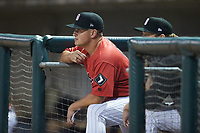 Birmingham Barons manager Justin Jirschele (9) watches from the dugout during the game against the Mississippi Braves at Regions Field on August 3, 2021, in Birmingham, Alabama. (Brian Westerholt/Four Seam Images)