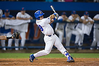 Mark Kolozsvary (28) of the Florida Gators follows through on his swing against the Wake Forest Demon Deacons in Game One of the Gainesville Super Regional of the 2017 College World Series at Alfred McKethan Stadium at Perry Field on June 10, 2017 in Gainesville, Florida.  The Gators defeated the Demon Deacons 2-1 in 11 innings.  (Brian Westerholt/Four Seam Images)