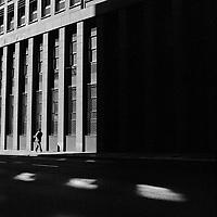 A man walks in the sunshine along Sour Street, Marshalltown.