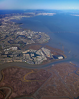 aerial photograph from the Bair Island tidal marsh wetlands to Redwood Shores and Foster City with the San Francisco International Airport and San Francisco in the background