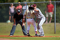 Central Michigan Chippewas first baseman Alex Borglin (6) catches a pickoff attempt throw as  Jake Palomaki (11) gets back to the bag with umpire Zach Tieche looking on during a game against the Boston College Eagles on March 8, 2016 at North Charlotte Regional Park in Port Charlotte, Florida.  Boston College defeated Central Michigan 9-3.  (Mike Janes/Four Seam Images)