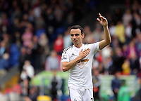 Pictured: Leon Britton of Swansea thanks away supporters at the end of the game<br />