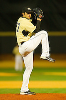 Relief pitcher Niko Spezial #27 of the Wake Forest Demon Deacons in action against the Northwestern Wildcats at Gene Hooks Field on February 26, 2011 in Winston-Salem, North Carolina.  Photo by Brian Westerholt / Four Seam Images
