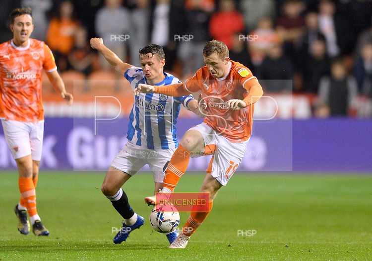 14/09/2021 Sky Bet Championship Blackpool v Huddersfield Town  <br /> <br /> Shane Lavery battles with Jonathan Hogg