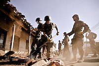 Chile, Aftermath of the tsunami in the area of Consitucion. Army people working in the streets of Chanco.