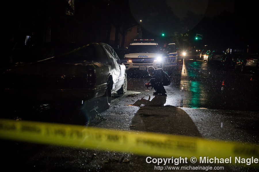 The NYPD investigates a crime scene where 4 people were shot, including a 1 year-old baby, at a cookout on Madison Street near Marcus Garvey Blvd early Monday morning on July 13, 2020 in the Bed-Study neighborhood in the Brooklyn borough of New York City.  Photograph by Michael Nagle