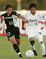 Ronnie Fair of the NY Power is step for step with Bai Jie of the Washington Freedom. The Freedom defeated the Power 4-2 on Saturday August 10, at Mitchel Athletic Complex, Uniondale, NY.