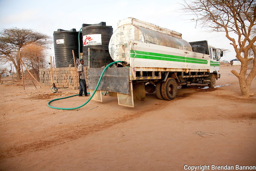 An MSF tanker truck delivers water to refugees in dadaab refugee camp in northern Kenya.